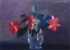 Red Flowers in Water Glass
